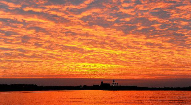 Sunrise over Newbiggin-by-the-Sea, Northumberland, as Britain is expected to enjoy its hottest days of the year so far
