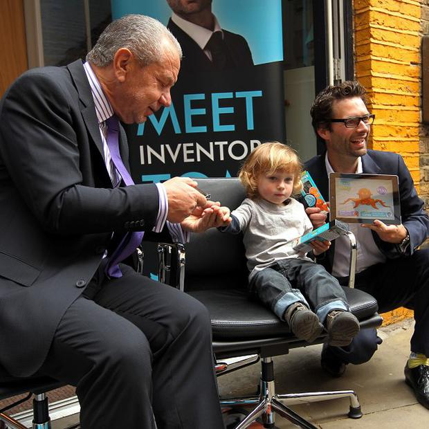 Lord Sugar and inventor Tom Pellereau, with Ren Butler aged two from Blackheath, unveil their latest product, a nail clipper for children