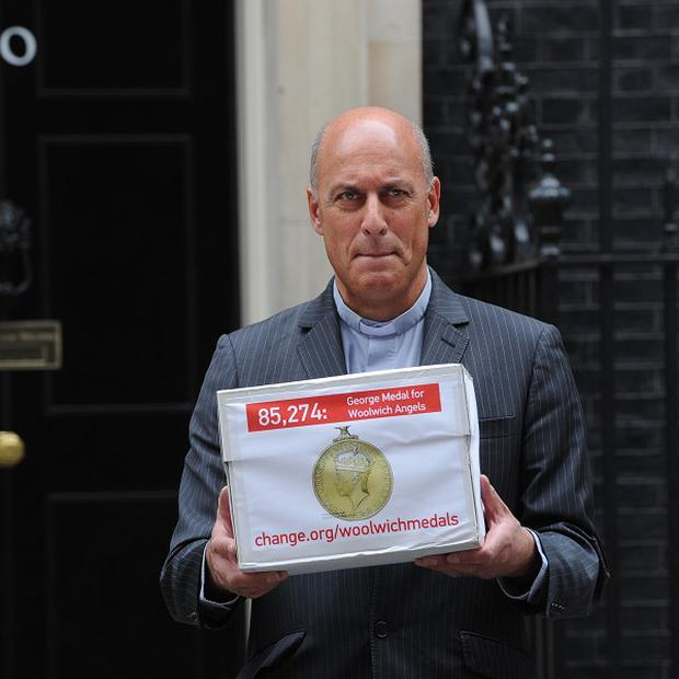 The Rev Jesse van der Falk, Rector of Woolwich delivers a petition to 10 Downing Street