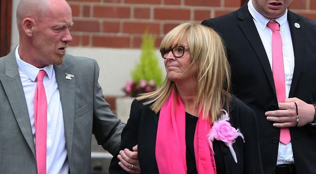 Paul and Diane Jones accompanied by boyfriend Nathan Hurcombe leave the funeral of their daughter Beth Jones