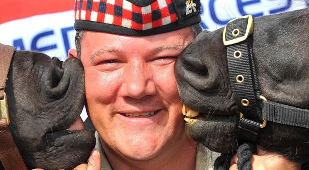 Corporal Mark Wilkinson with Cruachan III, left, and Cruachan IV (Mark Owens/Army HQ Scotland/MoD/Crown Copyright/PA)