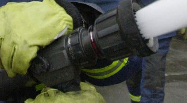 A firefighter found dead at his home in Colchester has been named as 48-year-old Martin Sibley