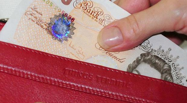 The average UK household had 157 pounds per week of discretionary income in May, a report says