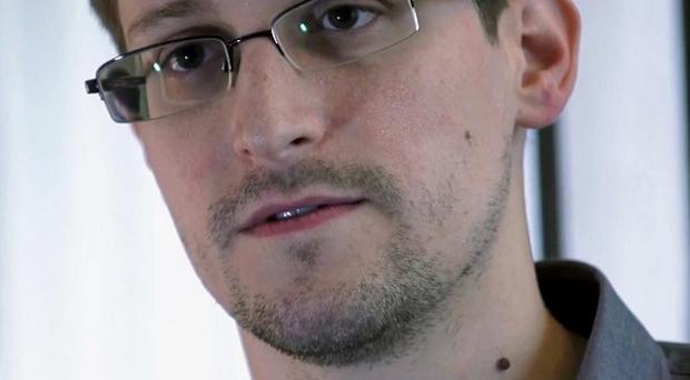 The US government has charged Edward Snowden with espionage and theft (AP/The Guardian)