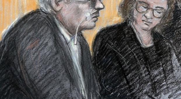 A court artist's sketch Moors Murderer Ian Brady, left, appearing via video at the tribunal at Manchester Civil Justice Centre (Elizabeth Cook/PA)