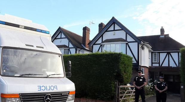 Surrey Police outside the home of Saad Al-Hilli in Claygate, Surrey, in September 2012