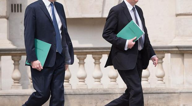 Chancellor George Osborne and Chief Secretary to the Treasury Danny Alexander leave the Treasury for the House of Commons