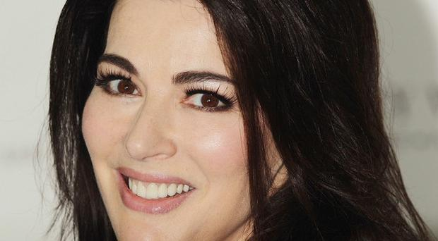 Nigella Lawson has become a poster girl for domestic violence awareness