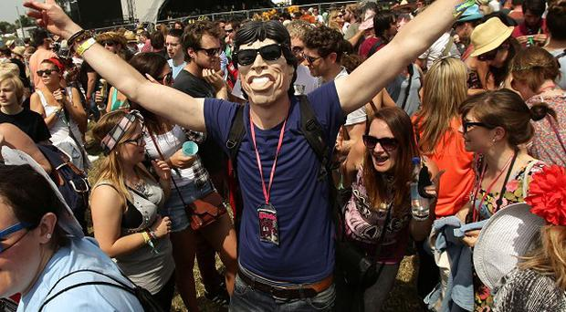 Festival goers dance to the music of the Rolling Stones at the Glastonbury Festival