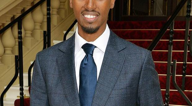 Mo Farrah arrives for the investiture ceremony at Buckingham Palace