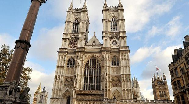 A campaigner was detained for allegedly defacing a statue at Westminster Abbey