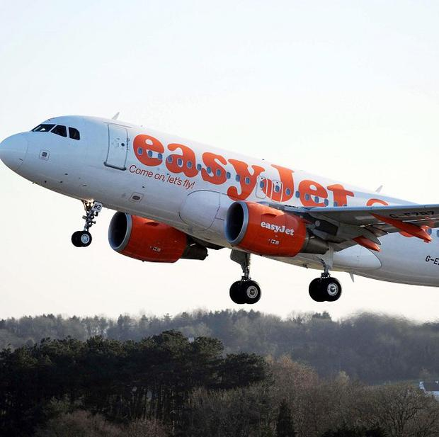 EasyJet passengers could face having to pay to put their hand luggage in the hold if it exceeds a new lower size restriction