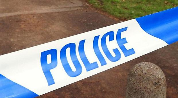 A man is being questioned after a woman's body was found in a car in Cornwall