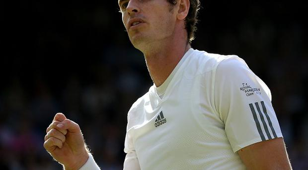 Andy Murray celebrates a point against Russia's Mikhail Youzhny