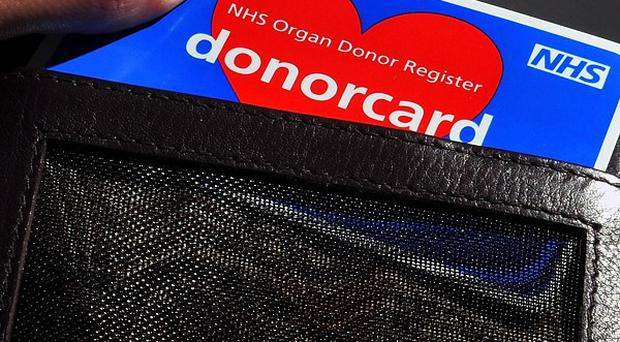 The current system relies on people signing up to a voluntary organ donation scheme and carrying a donor card