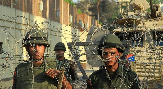 Army troops in front of the presidential palace in Cairo, Egypt (AP/Ahmed Gomaa)
