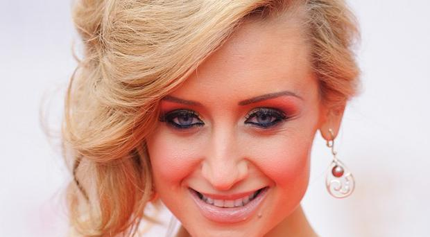 Catherine Tyldesley was among those pictured carrying bags for a fake brand at an event
