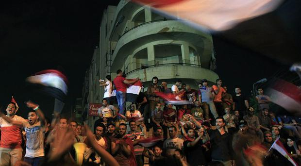 Egypt's president Mohammed Morsi is under arrest after being thrown out of office in a coup (AP)