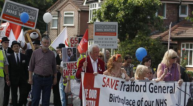 Demonstrators march from Trafford General Hospital to Golden Hill Park (PA)