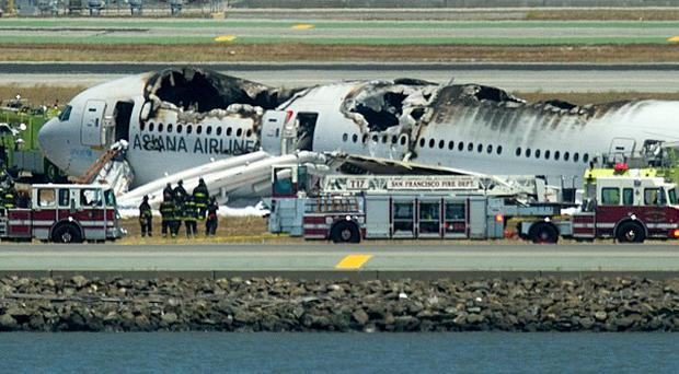 A fire truck sprays water on Asiana Flight 214 after it crashed at San Francisco International Airport (AP/Noah Berger)