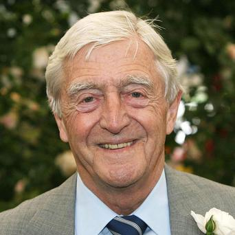Sir Michael Parkinson has revealed he has cancer