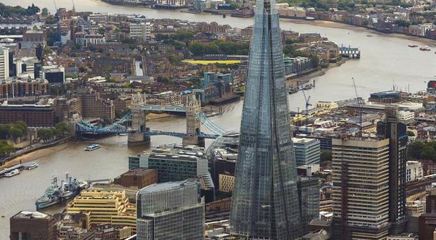 Greenpeace protesters are trying to scale the Shard skyscraper in London