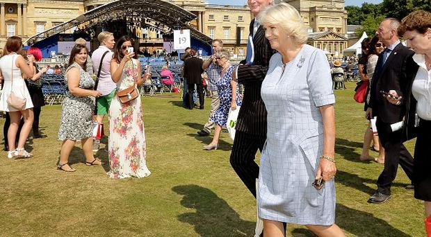The Duchess of Cornwall tours the stands at the Coronation Festival show in the Buckingham Palace Garden