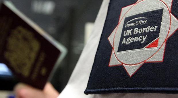 Home Secretary Theresa May axed the UK Border Agency, describing it as 'closed, secretive and defensive'