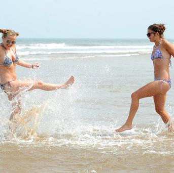 Sisters Abigail and Sarah Bell enjoy the hot weather at Saltburn-by-the-Sea in North Yorkshire