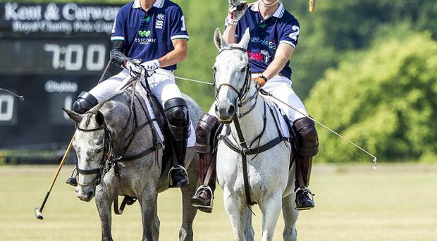 The Duke of Cambridge, right, plays polo in Hampshire in the Kent & Curwen Royal Charity Polo Cup (Charles Sainsbury-Plaice/Polofix/PA Wire)