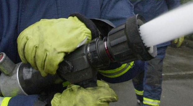 Firefighter Stephen Hunt was part of a team responding to a fire at Paul's Hair World in Oldham Street, Manchester