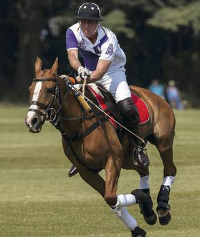 Duke of Cambridge in action during The Jerudong Trophy at Cirencester Park Polo Club in Cirencester