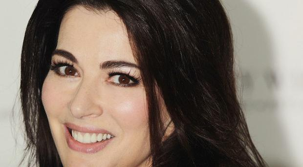 Nigella Lawson and estranged husband Charles Saatchi are both worth millions of pounds