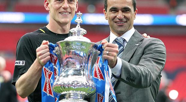 Roberto Martinez and Ben Watson pose with the trophy following Wigan's victory in the FA Cup final