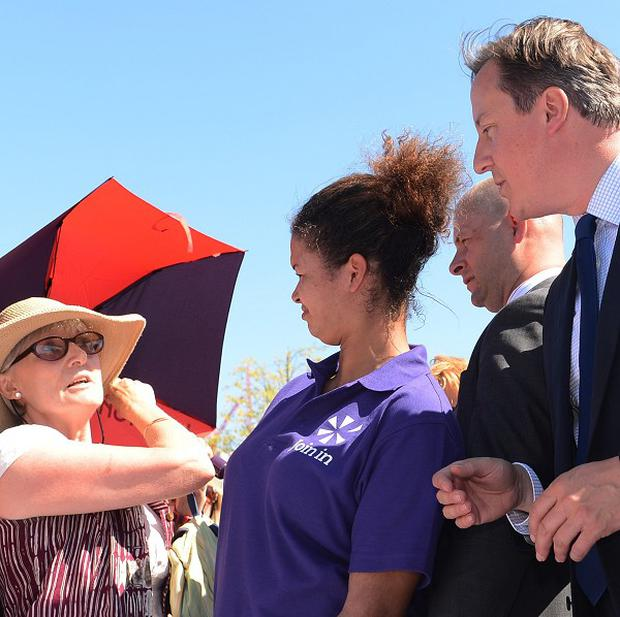 Hilary Kerr, left, berates Prime Minister David Cameron about the NHS at the Olympic Park in London