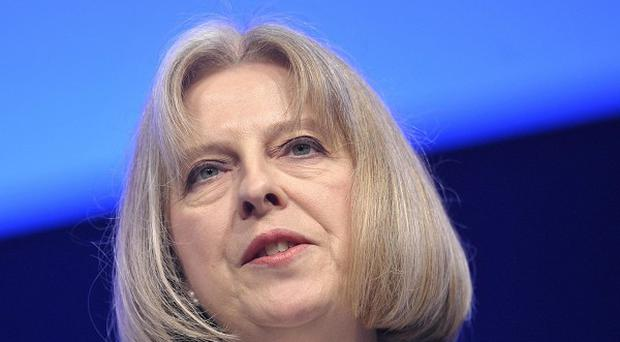 Home Secretary Theresa May said she backs anti-terror officers questioning a man over the murder of an 82-year-old