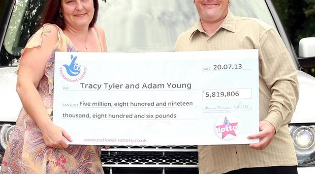 Tracy Tyler, 37, and partner Adam Young, 30, from Epping, who have won five million pound with a lucky dip ticket on the National Lottery