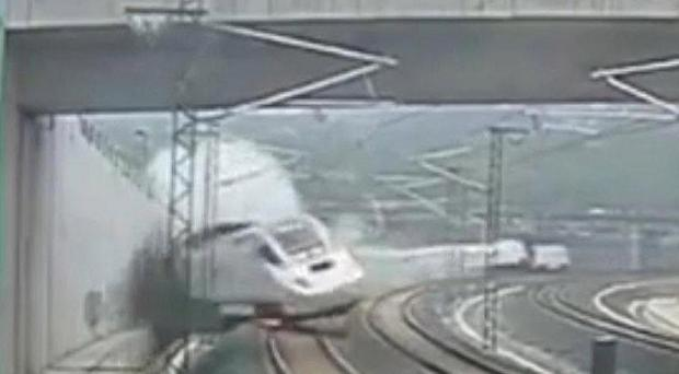 The moment the front of the train begins to derail as captured on security camera footage (AP)