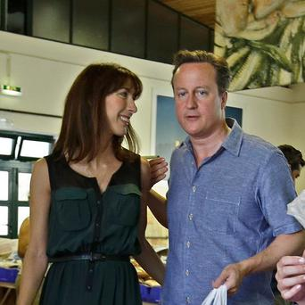 PM David Cameron and his wife Samantha at the Aljezur fish market in Portugal