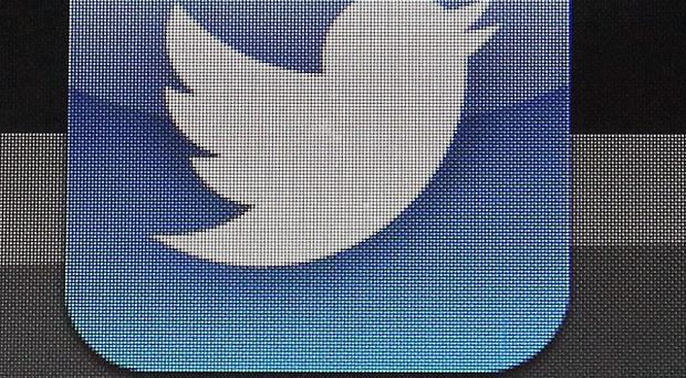A campaign is urging Twitter to introduce a button to allow speedy reporting of abuse