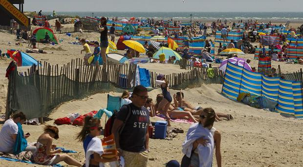 Day trippers enjoy the sun on West Wittering beach near Chichester, West Sussex