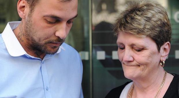 Paul King, the son of Ian Tomlinson, and his widow Julia speak to the press after the inquest into his death was delivered as an unlawful killing