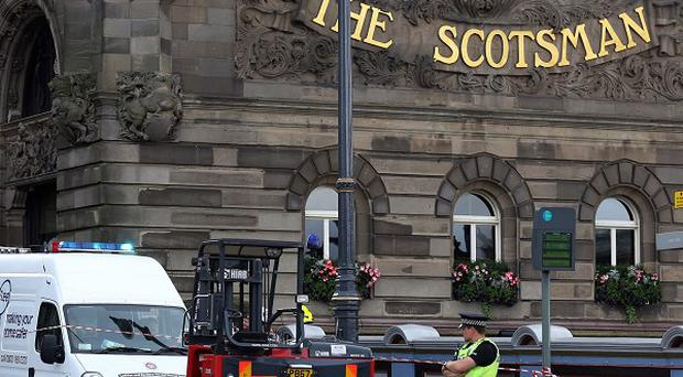 Emergency services attend the scene after two bodies were found at the five-star Scotsman Hotel