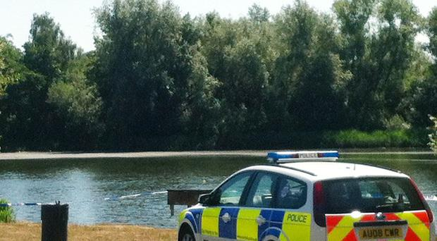 Police were called to a lake at the University of East Anglia after an angler spotted a woman's body in the water