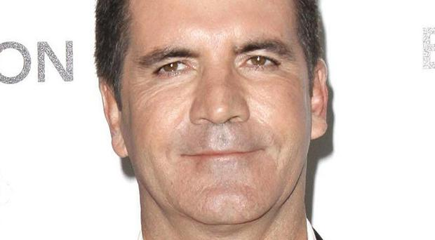 Simon Cowell has been named as a 'co-respondent' in Lauren Silverman's divorce papers by her husband Andrew, according to US reports