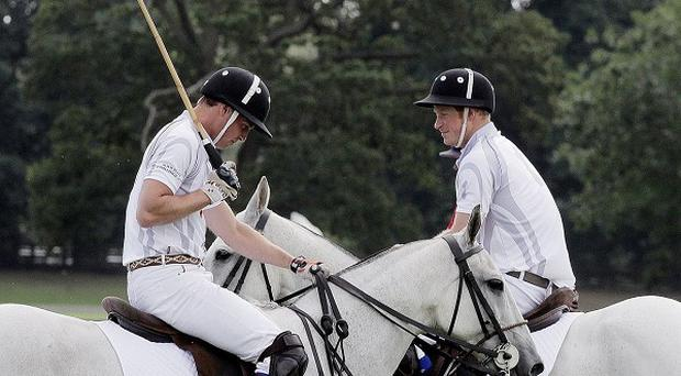 The Duke of Cambridge and Prince Harry play in a charity polo match at the Audi Polo Challenge, at Coworth Park, Berkshire
