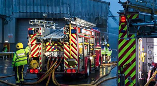 Emergency services tackling a blaze at Premier Waste paper recycling plant in the Perry Barr area of Birmingham (West Midlands Fire and Rescue Service/PA)