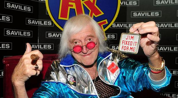 A Jimmy Savile themed float at the Lauder Common Riding event has been condemned as 'offensive and insensitive'