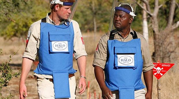 Prince Harry, left, is working in Angola on behalf of mine clearance charity the HALO Trust (Fiona Willoughby/HALO Trust/PA Wire)