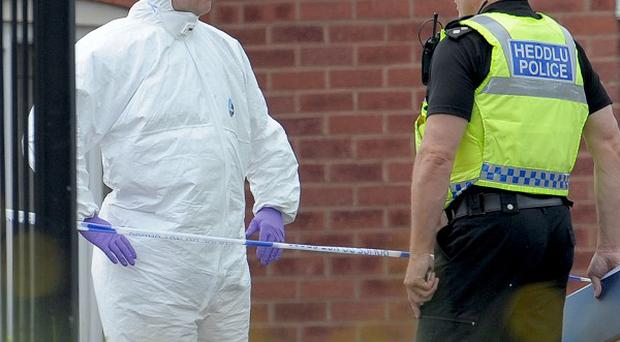 Police and forensic officers near the scene of a shooting in Newport